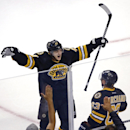 Boston Bruins defenseman Torey Krug (47) celebrates a goal by left wing Brad Marchand (63) during the first period of an NHL hockey game against the San Jose Sharks in Boston, Tuesday, Oct. 21, 2014. Krug assisted on the goal The Associated Press