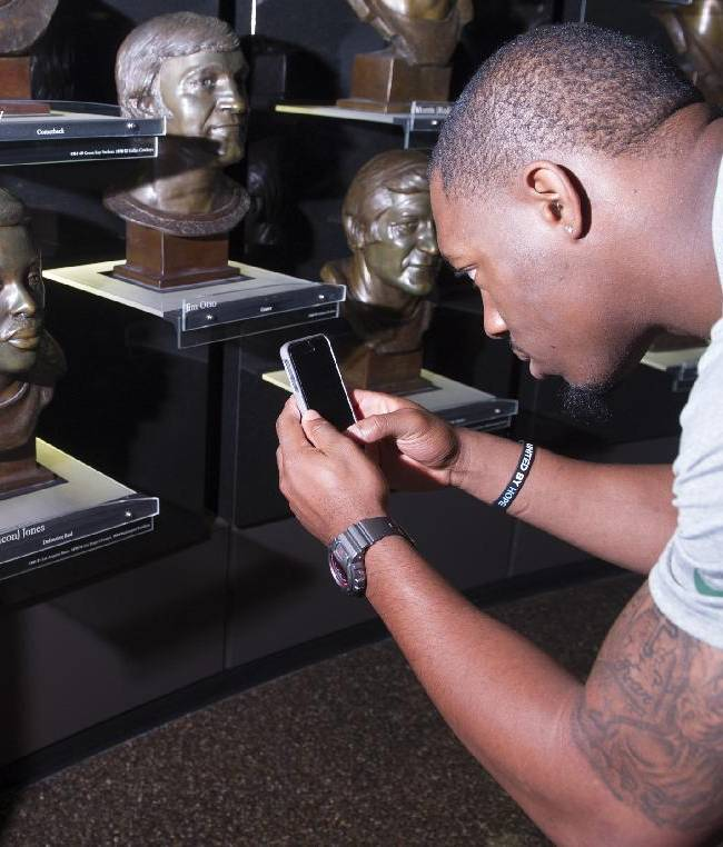 Green Bay Packers' rookie Ha Ha Clinton-Dix photographs the bust of Deacon Jones during the 2014 NFL Rookie Symposium at the Pro Football Hall of Fame in Canton, Ohio, Wednesday, June 25, 2014
