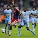 Bayern's Thomas Mueller, left, and Manchester City's Fernandinho, right, challenge during the Champions League Group E soccer match between FC Bayern Munich and Manchester City at Allianz Arena in Munich, southern Germany, Wednesday Sept. 17, 2014