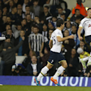 Tottenham's Nabil Bentaleb, right, celebrates after scoring the opening goal during their English League Cup soccer quarterfinal match between Tottenham Hotspur and Newcastle United at White Hart Lane stadium in London Wednesday, Dec. 17, 2014. (AP Photo