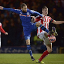 Rochdale's Matt Done and Stoke City's Ryan Shawcross, right, control the ball during their English FA Cup Fourth Round soccer match at Spotland Stadium, in Rochdale, England, Monday Jan. 26, 2015. (AP Photo / Martin Rickett, PA)