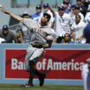 San Francisco Giants' Hunter Pence throws after fielding a ball hit for a single by Los Angeles Dodgers' Carl Crawford during the fifth inning of a baseball game on Friday, April 4, 2014, in Los Angeles The Associated Press