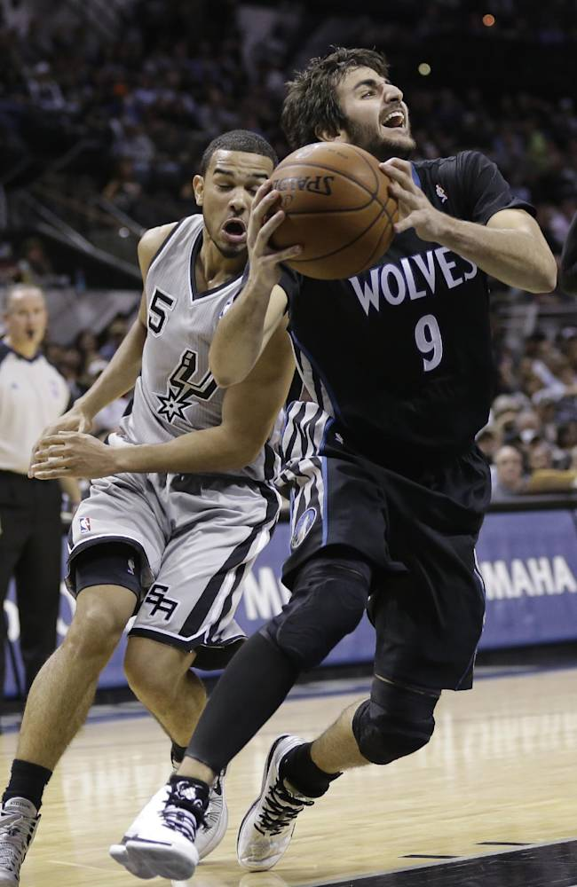 Minnesota Timberwolves' Ricky Rubio (9) drives around San Antonio Spurs' CoryJoseph (5) during the second half on an NBA basketball game, Sunday, Jan. 12, 2014, in San Antonio. San Antonio won 104-86
