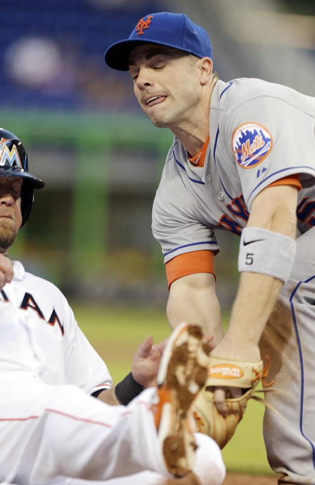 New York Mets third baseman David Wright, right, tags out Miami Marlins' Casey McGehee as he slides into third base during the inning of a baseball game, Tuesday, May 6, 2014, in Miami