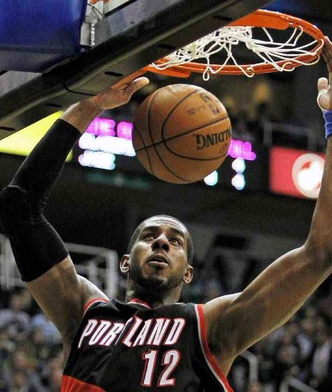 In this Feb. 1, 2013, file photo, Portland Trail Blazers forward LaMarcus Aldridge (12) dunks the ball against the Utah Jazz in the first half during an NBA basketball game in Salt Lake City. The late-game