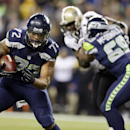 In this Dec. 2, 2013, file photo, Seattle Seahawks' defensive end Michael Bennett (72) returns a fumble for a touchdown during an NFL football game against the New Orleans Saints in Seattle. The Seahawks announced Monday, March 10, 2014, that free-agent B
