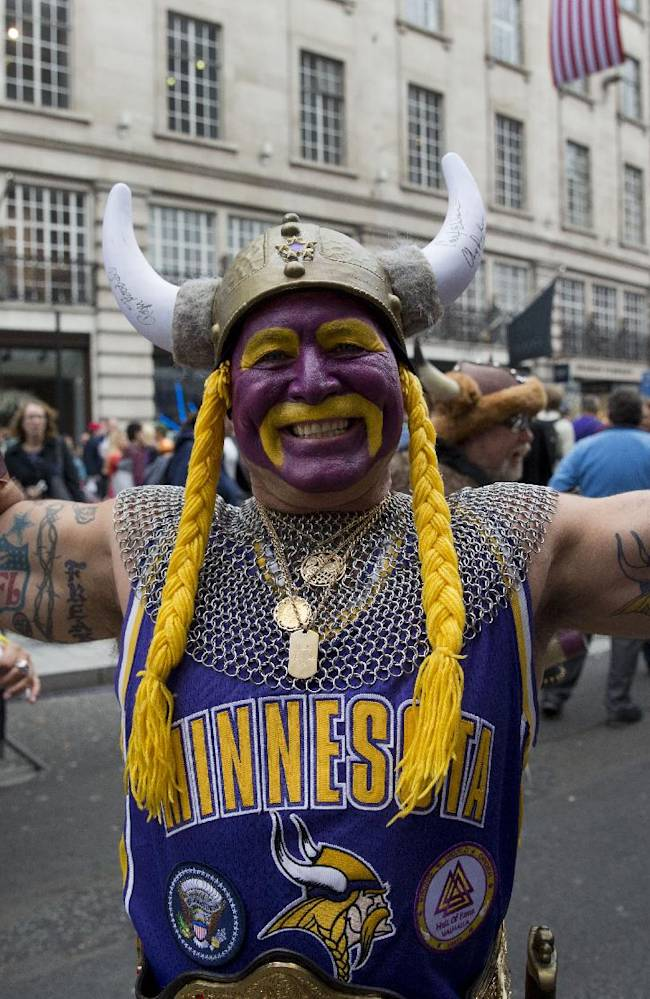Minnesota Vikings fan Syd Davy from Winnipeg in Canada, poses for photographs during an NFL fan rally event in Regent Street, London, Saturday, Sept. 28, 2013.  The Minnesota Vikings are to play the Pittsburgh Steelers at Wembley stadium in London on Sunday, Sept. 29 in a regular season NFL game
