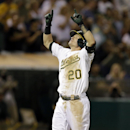 Oakland Athletics' Josh Donaldson celebrates after hitting a two-run home run off Houston Astros' Philip Humber in the sixth inning of a baseball game Friday, Sept. 6, 2013, in Oakland, Calif. (AP Photo/Ben Margot)