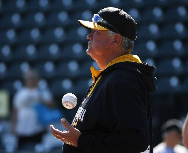 Pittsburgh Pirates' Clint Hurdle tosses a ball as he watches batting practice before  an exhibition spring training baseball game  against the Boston Red Sox in Bradenton, Fla., Monday, March 3, 2014