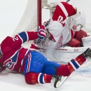 Montreal Canadiens' Thomas Vanek collides with Detroit Red Wings goaltender Jonas Gustavsson during the first period of an NHL hockey game in Montreal, Saturday, April 5, 2014 The Associated Press