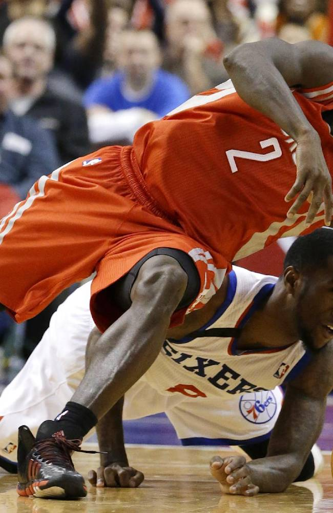 Houston Rockets' Patrick Beverley (2) and Philadelphia 76ers' Tony Wroten (8) chase down a loose ball during the second period of an NBA basketball game, Wednesday, Nov. 13, 2013, in Philadelphia. Philadelphia won 123-117 in overtime