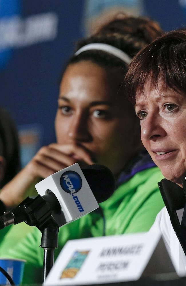 Notre Dame head coach Muffet McGraw, right, answers questions during a news conference at the NCAA women's Final Four college basketball tournament Monday, April 7, 2014, in Nashville, Tenn. Notre Dame is scheduled to face Connecticut in the championship game Tuesday