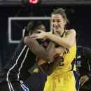Michigan guard Kate Thompson, right, and Duke guard Chelsea Gray, left, battle for the ball during the first half of an NCAA college basketball game at Crisler Arena in Ann Arbor, Mich., Wednesday, Nov. 28, 2012. (AP Photo/Carlos Osorio)