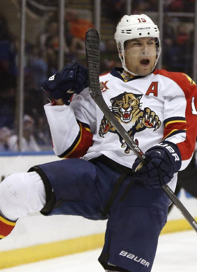 Florida Panthers right wing Scottie Upshall (19) reacts after scoring a goal in the third period of an NHL hockey game against the New York Islanders in Uniondale, N.Y., Sunday, March 2, 2014. The Panthers defeated the Islanders 5-3