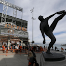 Fans wait to enter AT&T Park before Game 5 of the National League baseball championship series between the San Francisco Giants and the St. Louis Cardinals Thursday, Oct. 16, 2014, in San Francisco. (AP Photo/Eric Risberg)