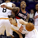 Portland Trail Blazers' Damian Lillard, rear, defends against Phoenix Suns' Goran Dragic, of Slovenia, during the first half of an NBA basketball game, Wednesday, Nov. 27, 2013, in Phoenix The Associated Press