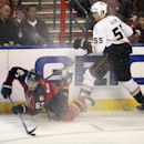 Anaheim Ducks' Bryan Allen (55) watches as Florida Panthers' Marcel Goc (57) goes for the puck during the second period of an NHL hockey game in Sunrise, Fla., Tuesday, Nov. 12, 2013 The Associated Press