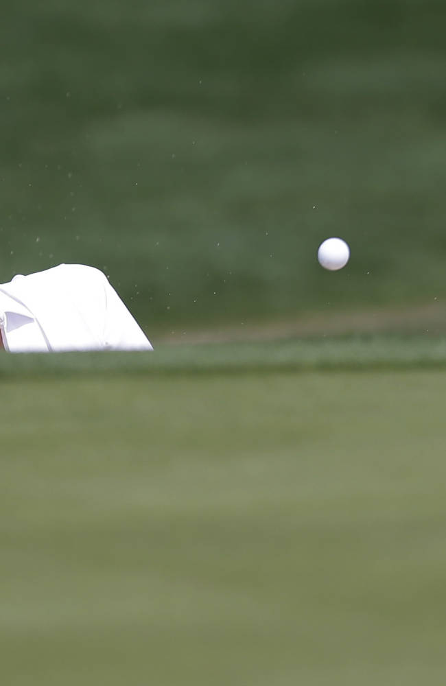 Aaron Baddeley, of Australia, hits from a sand trap on the seventh hole during the third round of the Texas Open golf tournament, Saturday, March 29, 2014, in San Antonio