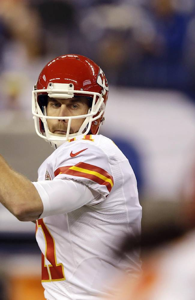 Kansas City Chiefs quarterback Alex Smith (11) throws before an NFL wild-card playoff football game against the Indianapolis Colts Saturday, Jan. 4, 2014, in Indianapolis