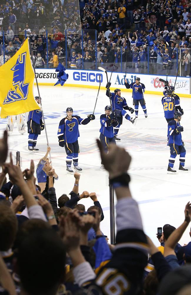 St. Louis Blues players acknowledge the fans after their triple overtime victory during Game 1 of a first-round Stanley Cup playoff game between the St. Louis Blues and the Chicago Blackhawks on Thursday, April 17, 2014, at the Scottrade Center in St. Louis