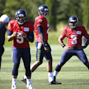 Seattle Seahawks quarterback Russell Wilson (3) stretches while working out with Terrelle Pryor and B.J. Daniels (5) at an NFL football camp practice Sunday, July 27, 2014, in Renton, Wash The Associated Press