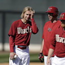 Arizona Diamondbacks pitcher Bronson Arroyo, left, stands with teammates during baseball spring training Wednesday, Feb. 12, 2014, in Scottsdale, Ariz. The Diamondbacks made the signing of Arroyo official Wednesday, five days after the two-year, $23.5 mil