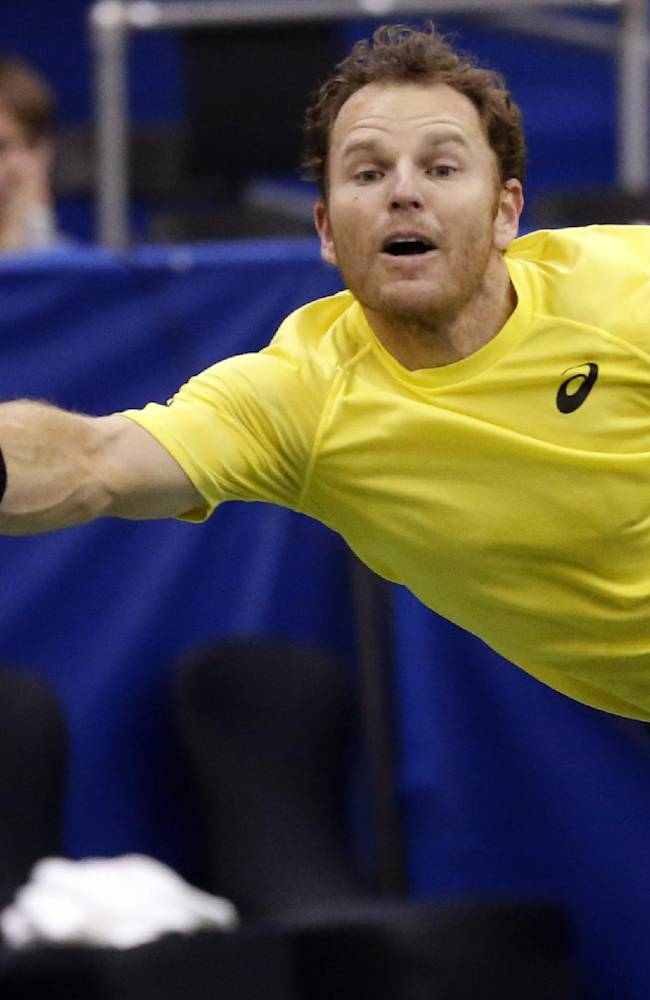 Michael Russell, of the United States, hits a return to Kei Nishikori, of Japan, in the semifinals at the U.S. National Indoor Tennis Championships on Saturday, Feb. 15, 2014, in Memphis, Tenn. Nishikori won 6-3, 6-2