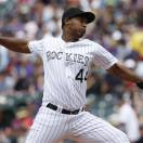 Colorado Rockies starting pitcher Juan Nicasio works against the San Francisco Giants in the first inning of a baseball game in Denver, Sunday, May 19, 2013. (AP Photo/David Zalubowski)
