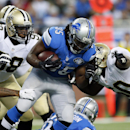 Detroit Lions running back Joique Bell (35) is stopped by New Orleans Saints outside linebacker Parys Haralson (98) and middle linebacker Curtis Lofton (50) during the first half of an NFL football game in Detroit, Sunday, Oct. 19, 2014 The Associated Pre