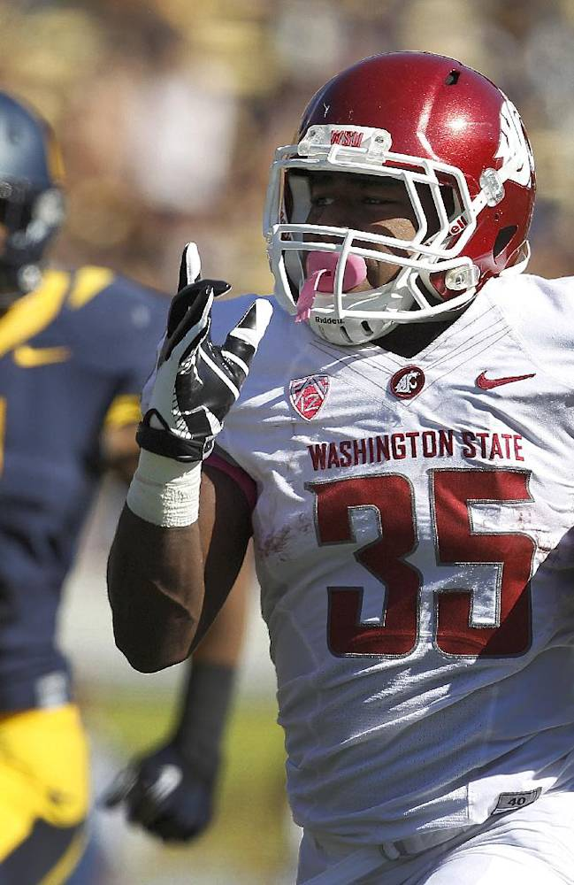Washington State running back Marcus Mason (35) runs for a touchdown past California safety Jason Gibson (9) during the first half of an NCAA college football game in Berkeley, Calif., Saturday, Oct. 5, 2013