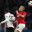Manchester United's Alexander Buttner, right, heads the ball under pressure from Donetsk's Darijo Srnatheir during Champions League group A soccer match between Manchester United and Shakhtar Donetsk at Old Trafford Stadium, Manchester, England, Tuesday,