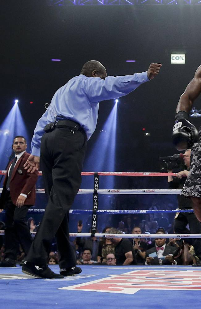 Referee Robert Byrd, center, directs Timothy Bradley, right, to his corner at the end of the fifth round against Juan Manuel Marquez during a WBO welterweight title fight, Saturday, Oct. 12, 2013, in Las Vegas. Bradley won by split decision