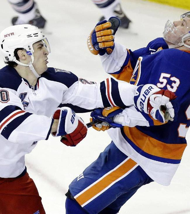 New York Rangers' Chris Kreider (20) punches New York Islanders' Casey Cizikas (53) during the third period of an NHL hockey game on Friday, Jan. 31, 2014, in New York. The Rangers won the game 4-1