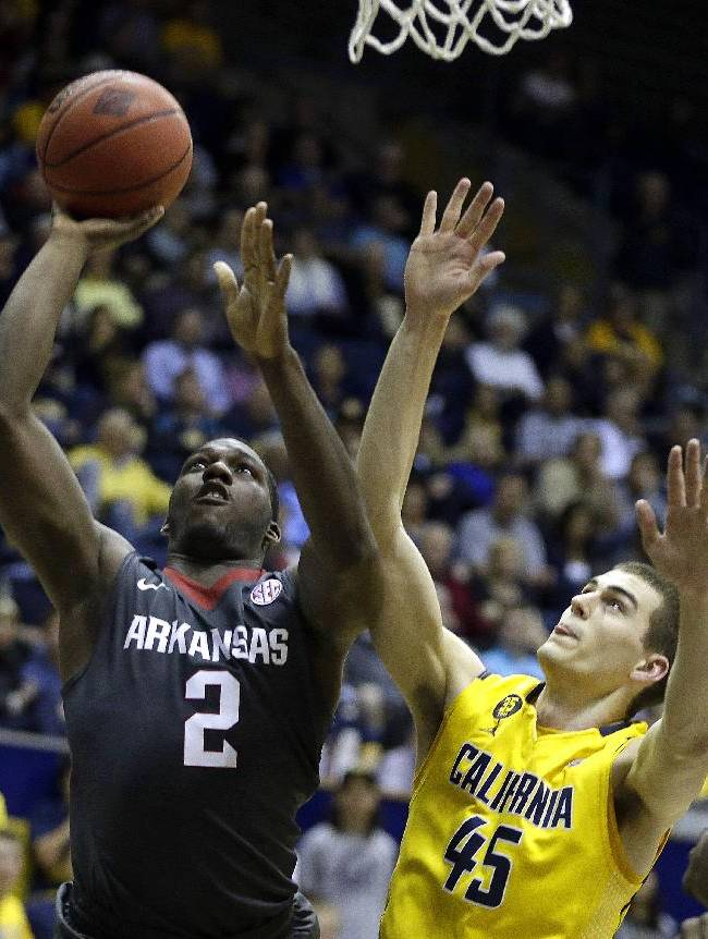 Arkansas forward Alandise Harris (2) shoots against California's David Kravish, right, in the first half of an NCAA college basketball game in the NIT tournament Monday, March 24, 2014, in Berkeley, Calif. (AP