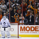 Toronto Maple Leafs' Jonathan Bernier sweeps the ice in front of the net after giving up a goal to Philadelphia Flyers' Wayne Simmonds during the third period of an NHL hockey game, Friday, March 28, 2014, in Philadelphia. Philadelphia won 4-2 The Associa