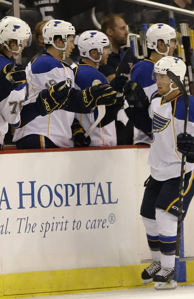 St. Louis Blues center Jaden Schwartz, right front, celebrates with teammates after scoring a goal against the Tampa Bay Lightning during the second period of an NHL preseason hockey game in Orlando, Fla., Wednesday, Sept. 18, 2013