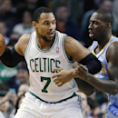 Denver Nuggets' J.J. Hickson, right, defends against Boston Celtics' Jared Sullinger (7) in the second quarter of an NBA basketball game in Boston, Friday, Dec. 6, 2013 The Associated Press