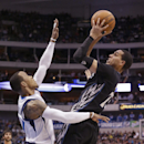 Minnesota Timberwolves guard Kevin Martin (23) shoots against Dallas Mavericks guard Monta Ellis (11) during the first half an NBA basketball game Wednesday, March 19, 2014, in Dallas The Associated Press