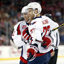 Washington Capitals defenseman Karl Alzner, right, celebrates with teammate Matt Niskanen after scoring a goal against the New Jersey Devils during the first period of an NHL hockey game, Saturday, Dec. 6, 2014, in Newark, N.J The Associated Press