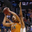 Texas center Imani McGee-Stafford (34) shoots in front of West Virginia center Asya Bussie in the first half of an NCAA college basketball game in the semifinals of the Big 12 Conference women's tournament in Oklahoma City, Sunday, March 9, 2014. (AP Photo/Sue Ogrocki)