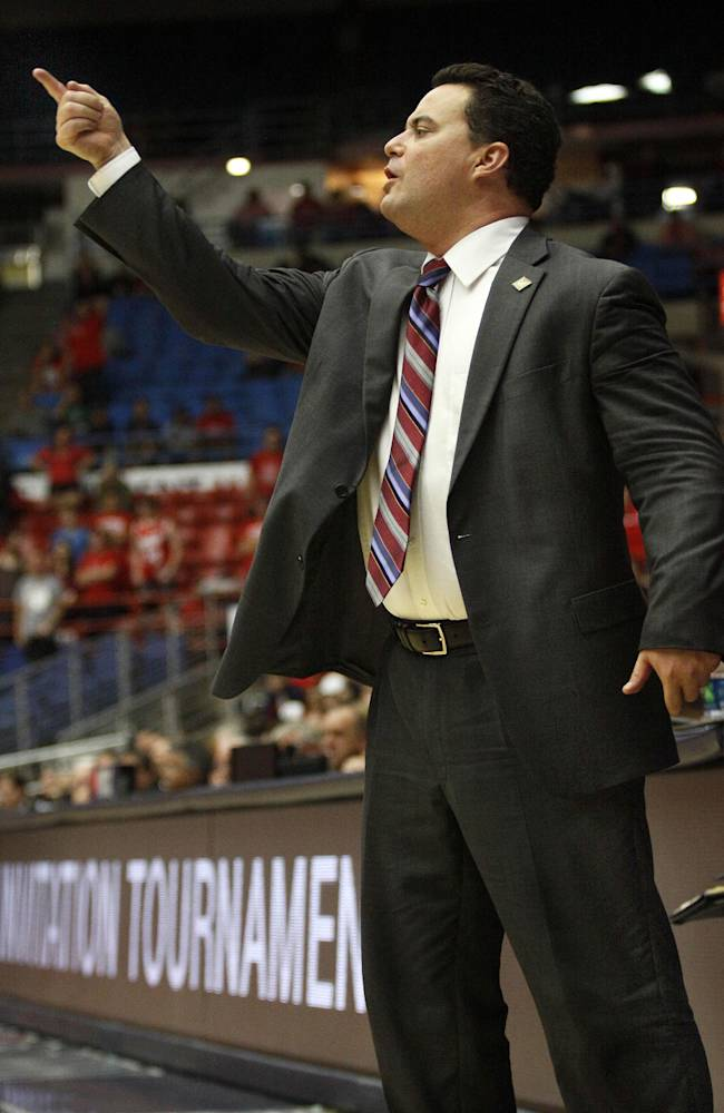 Arizona's head coach Sean Miller signals his players in the second half of an NCAA college basketball game against Fairleigh Dickinson, Monday, Nov. 18, 2013 in Tucson, Ariz. This is in the first round of the Preseason NIT
