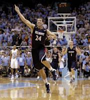 Belmont's J.J. Mann (24) celebrates near the end of an NCAA college basketball game against North Carolina in Chapel Hill, N.C., Sunday, Nov. 17, 2013. Belmont upset North Carolina 83-80. (AP Photo/Gerry Broome)