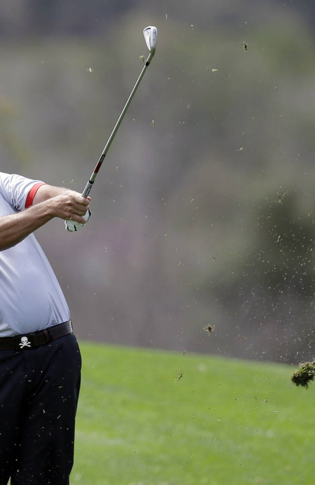 Pat Perez hits from the 18th fairway during the first round of the Valero Texas Open golf tournament, Thursday, March 27, 2014, in San Antonio