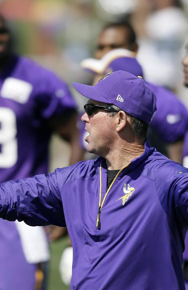 Minnesota Vikings head coach Mike Zimmer directs his team during NFL football training camp, Friday, July 25, 2014, in Mankato, Minn