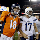 Denver Broncos quarterback Peyton Manning (18) greets San Diego Chargers quarterback Philip Rivers (17) after an NFL football game, Thursday, Oct. 23, 2014, in Denver. The Broncos won 35-21 The Associated Press
