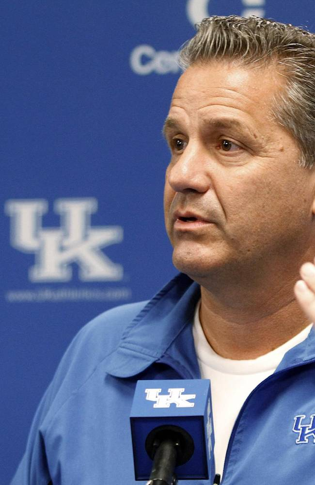 Kentucky coach John Calipari answers a question during the NCAA men's college basketball team's media day in Lexington, Ky., on Tuesday, Oct. 15, 2013