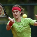 Slovakia's Lukas Lacko returns the ball to USA's Sam Querrey during their first round match of the French Open tennis tournament at the Roland Garros stadium Sunday, May 26, 2013 in Paris. (AP Photo/Christophe Ena)