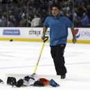 In this photo provided by SFBay, caps are cleared off the ice after San Jose Sharks' Brent Burns third goal of an NHL hockey game against the St. Louis Blues during the third period on Friday, Nov. 29, 2013, in San Jose, Calif. The Sharks won 6-3 The Asso