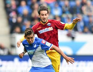 Hoffenheim's   Brazilian player Roberto Firmino, left, challenges for the ball with Paderborn's  Mario Vrancic. during the German first division Bundesliga soccer match between TSG 1899 Hoffenheim and SC Paderborn in Sinsheim, Germany, Saturday Oct. 25, 2014. (AP Photo/dpa,  Uwe Anspach)