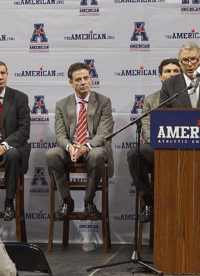 American Athletic Conference commissioner Mike Aresco speaks out against paying players during a news conference at the league's NCAA college basketball media day on Wednesday, Oct. 16, 2013, in Memphis, Tenn